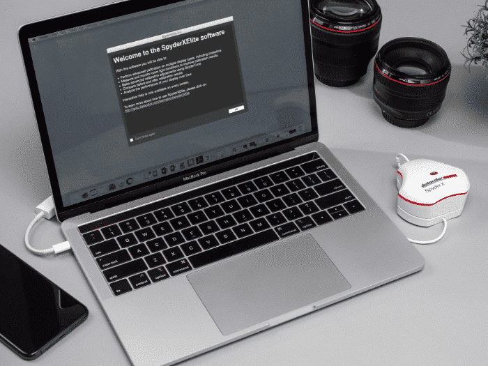 SpyderX display calibration tool connected to laptop with software downloading